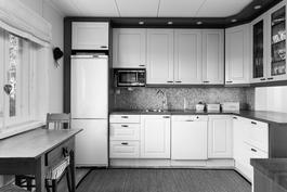 Talon henkeen istuva keittiö