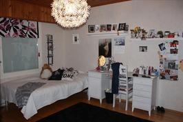 Yksi makuuhuoneista
