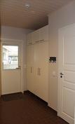 Kodinhoitohuone, jonka yhteydessä vaatehuone