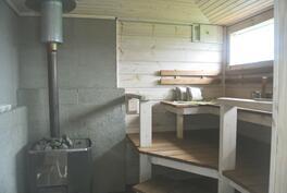 piharakennuksen mahtava puulämmitteinen sauna