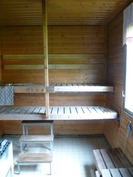 sauna, saunassa puukiuas ja vesipata