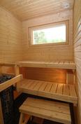 Kuva valmistuneesta ja myydystä asunnosta. Sauna.