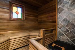 Laasukas sauna, jossa ainavalmis kiuas.