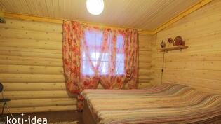 Huvilan isompi makuuhuone
