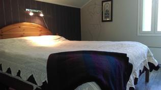 Yläkerran jaettu makuuhuone