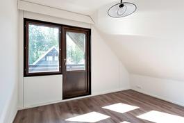 Jyrkkä katto tuo huoneisiin enemmän tilaa