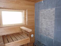 Taloyhtiön viihtyisä saunaosasto