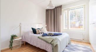 Valokuva asunnon  makuuhuoneesta