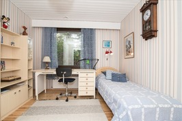 Yksi makuuhuoneista Ett av fem sovrum