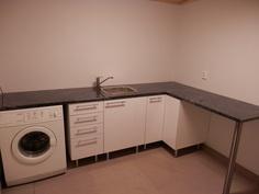 Kodinhoitohuoneessa toimivat tilat.