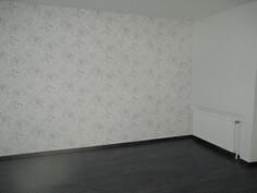 Yläkerran asunnon makuuhuone