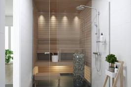 Tyylikäs lasiseinä tuo saunaan ja kylpyhuoneeseen valoisuutta ja avaruutta.